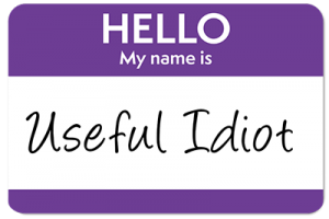 """Name tag that reads """"Useful Idiot"""""""