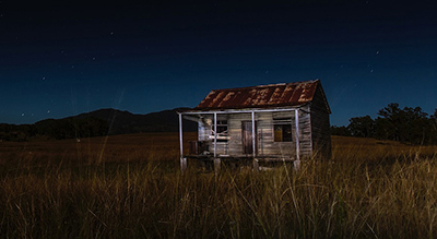 night shot of a shack