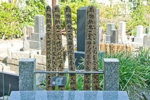 kaimyo on wooden stakes in Japanese graveyard