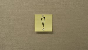 sticky note with exclamation point
