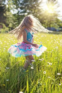 young girl dancing in the sunshine