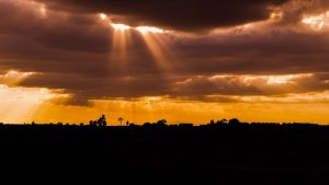 clouds with golden sun rays