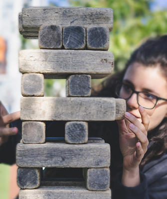 young woman playing Jenga