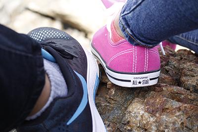 girl's shoe next to guy's shoe