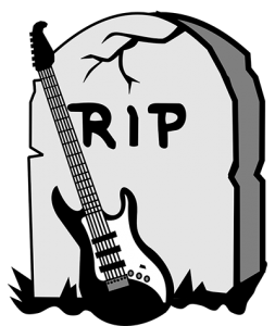 electric guitar leaning against a tombstone