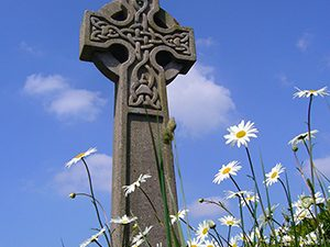 Celtic cross in a field of daisies