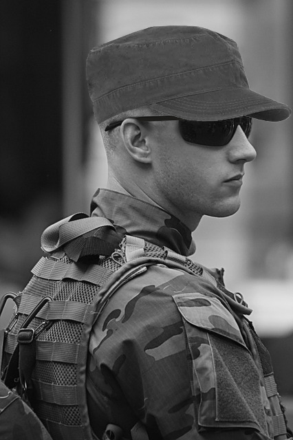 soldier in hat and sunglasses