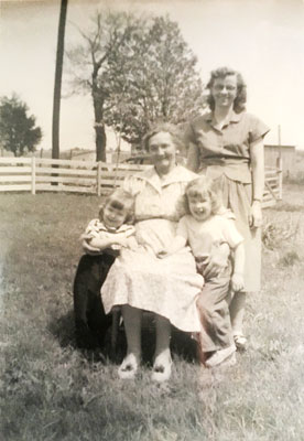 the author as a little girl with her sister, mother, and grandmother